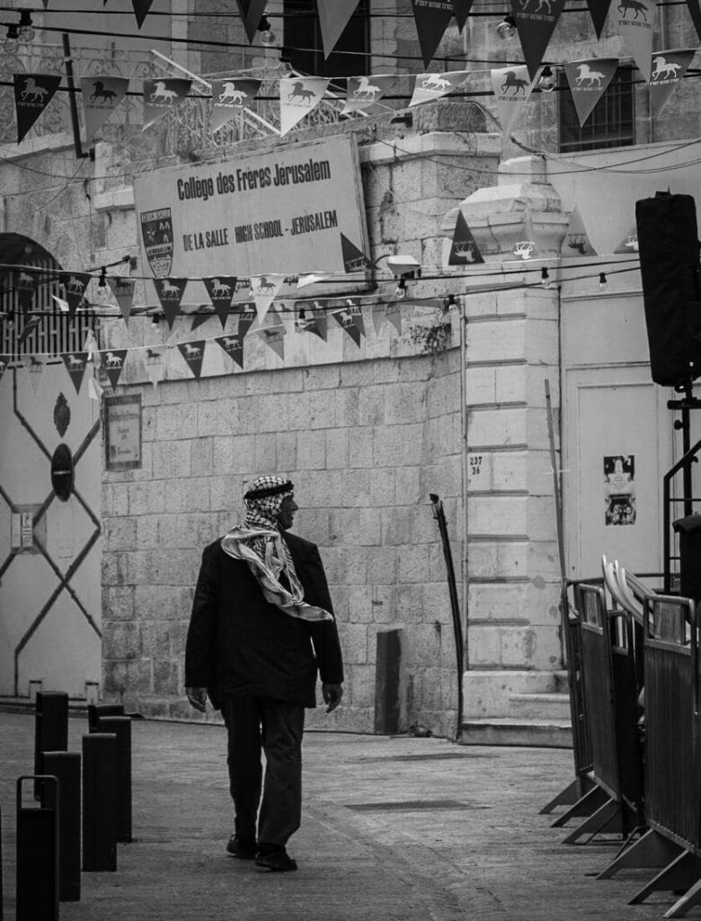 An old Palestinian man walking in the streets of the Old City of Jerusalem