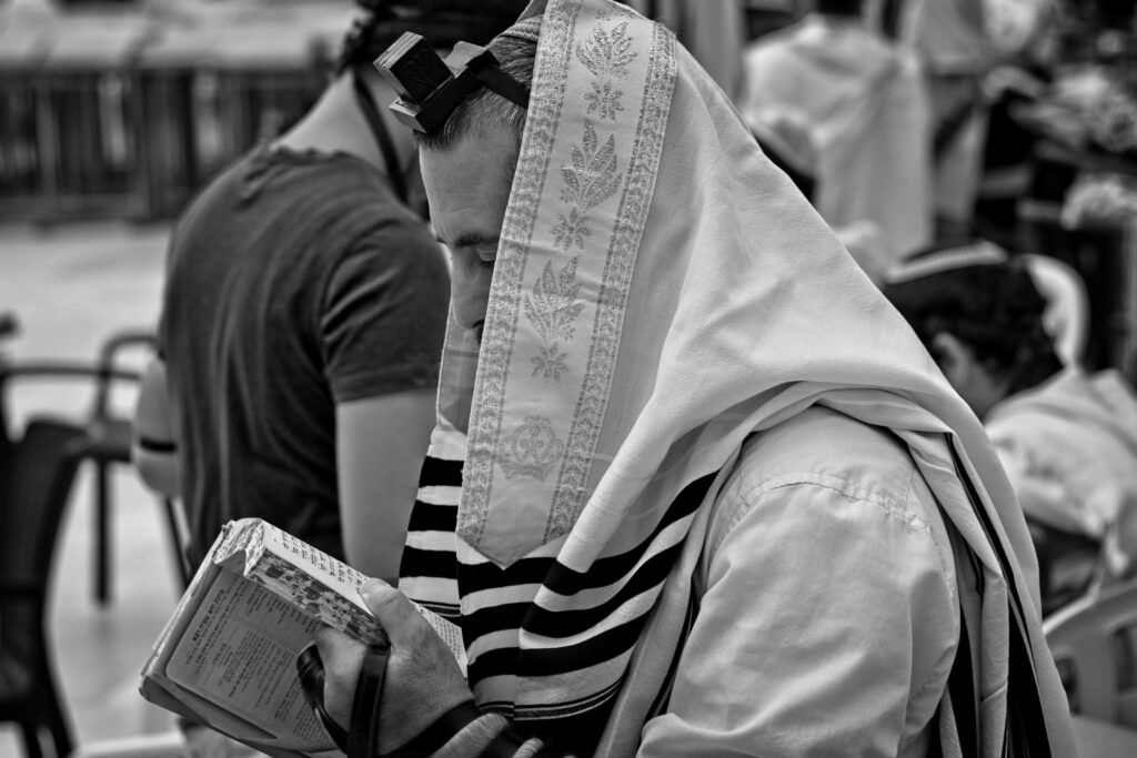 A Jew praying morning prayer at the Western Wall
